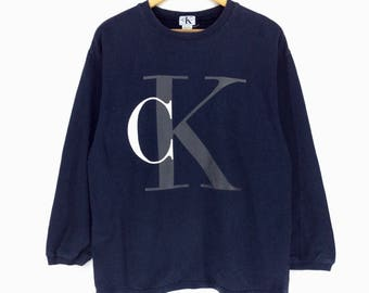 Vintage Calvin Klein Sweatshirt Medium Size Made In Peru Pullover Jumper Big Logo Spell out Retro Style Rap Tees Hip Hop Swag