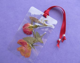Pressed flowers bookmark. Laminated bookmark with real pressed flowers. One of a kind bookmark made from nature.