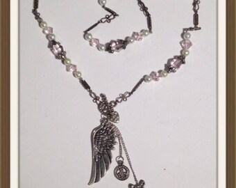Handmade MWL pink, pearl and silver necklace with a wing. 0074