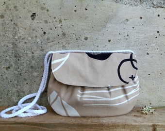 Sand clutch with black and white print. Medium size fabric bag with braided cord strap.