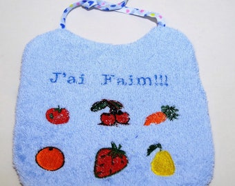 Personalized reversible bib with drawings of vegetables and fruits.