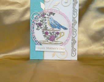 Handmade Mother's Day card featuring a bird in a tea cup.