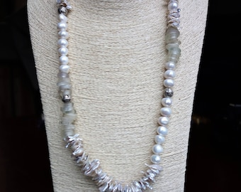 A stunning statement made of old frosty Dogon trade beads, unusual flat fresh water pearls, round fresh water pearls and silver beads