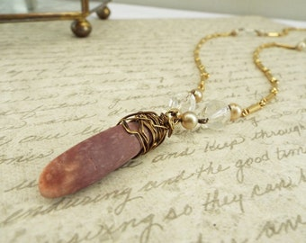 Rumi - Purple sea urchin pendant with crystal and gold tone chain