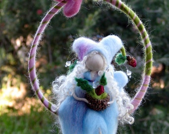 Waldorf inspired Needle felted fairy sitting on a twig holding roses Mobile