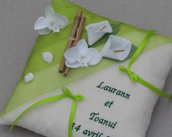 In lime green zen nature theme wedding decor bamboo, lilies, orchids, personalized pillow is embroidered alliance, names and date