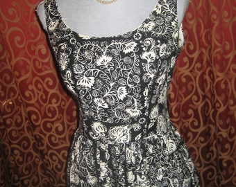 "1950's, 34"" bust dress is of waffled cotton black and white tropical print."