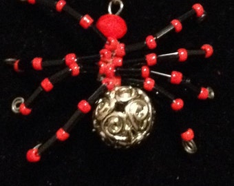 Four Spider beaded necklaces