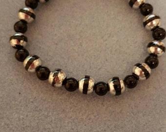 Black bracelet; silver bracelet; stripe bracelet; striped bracelet; beaded bracelet; stretch bracelet; adjustable bracelet; elastic bracelet
