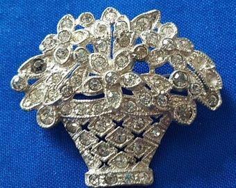 Silver tone rhinestone flower basket brooch