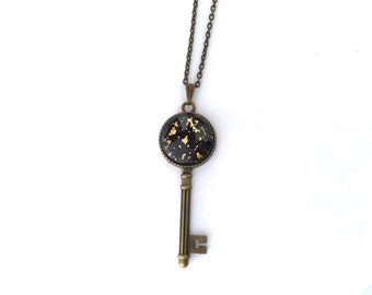 Key to my heart neclace. Black with 18K Gold Flake Accents. Antique brass skeleton key pendant. Unisex. Chest length chain.