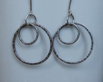 Organic hammered sterling silver hoop earrings. 925 silver hoops. Hammered oxidised boho dangle drop hoop earrings. Everyday or gift