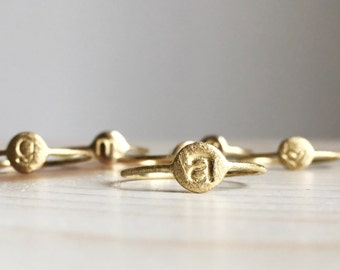 Customizable tiny gold rings with small letter, heart, star or smile. New born tiny gold rings.