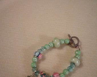 Bracelet with shades of green beads