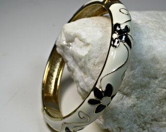 Signed JTF Sequin Gold Tone White, Gold and Black Floral Enamel Clamper Bangle Bracelet