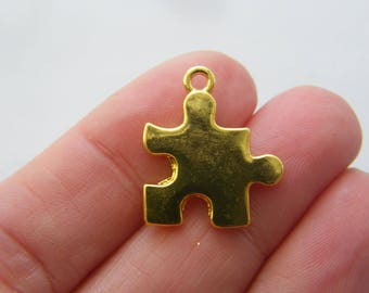 2 Puzzle piece charms gold tone GC89