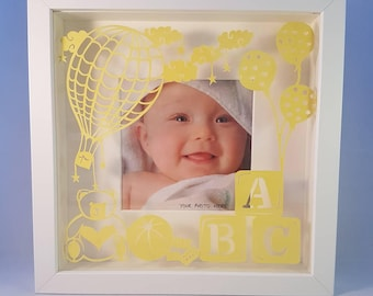 New baby photo frame. Your photo framed with a handcut papercutting that can be personalised!