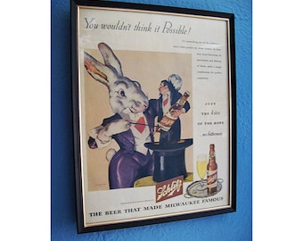 vintage Schlitz beer advertisement 1940s dive bar kitsch rabbit magician rockabilly decor