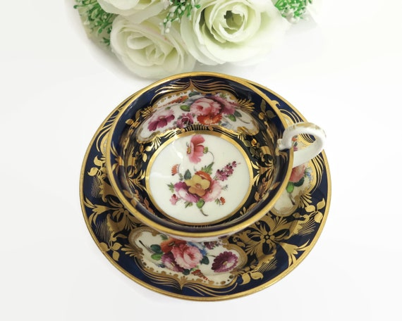 Reserved for Felicity - Antique Coalport hand painted cup and saucer, bunches of flowers, cobalt blue background with gilt, 1800 - 1820