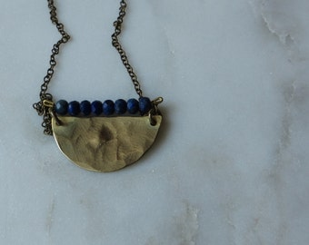 brass semi-circle necklace with lapis lazuli