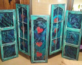 Paintings Framed in Repurposed Cabinet Doors Turquoise and Black Colors DelMarq