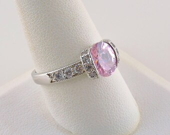 Size 10 Silver Tone And 2.25ct Oval Pink Rhinestone Ring With Accent Stones
