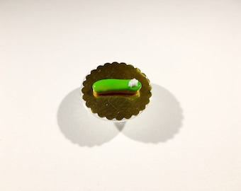 Miniature Flash green frosting and whipped cream polymer clay decoration