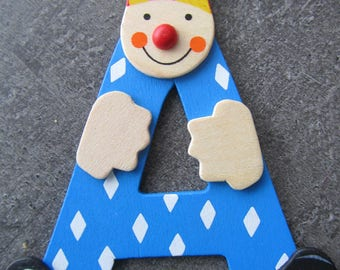 "Painted wood letter - representing the letter ""A"" in the form of a clown"