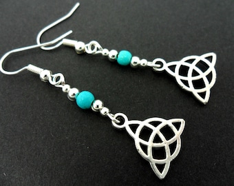 A pair of tibetan silver & turquoise bead celtic knot dangly earrings. new.