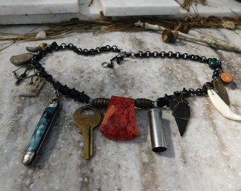 The Woodsman's Cottage Necklace Rustic Tribal Unisex Badass Ax Head, Pocketknife, Arrowhead, Coyote Tooth & Claw, Lake Stone, Deer Antler