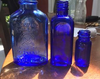 Three Different Antique Cobalt Blue Medicine Bottles