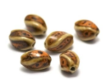 "4 ceramic beads ""twisted olive"" 17 x 10 mm, leopard"