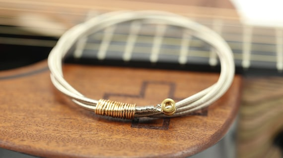 items similar to mens guitar bass string bangle bracelet with bass ball ends gold or silver. Black Bedroom Furniture Sets. Home Design Ideas