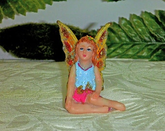 Confetti Fairy. Fairy Figurine - Confetti Series. Sparkly Fairy. SUEDE BLUE and RED Frosted. Amber-Yellow Wings.Yellow Flower in her Hair.