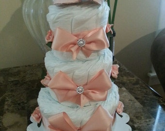 Three Tier Coral Diaper Cake with Decorative Booties