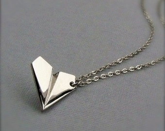One Direction Harry Styles paper airplane necklace. Free cuff bracelet with every 25.00 purchase