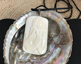 Mermaid with Manatee, Bone Pendant on a Satin cord.