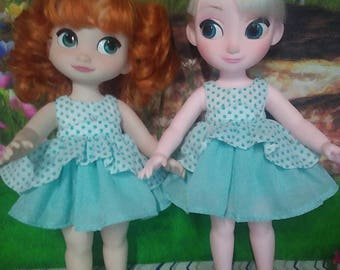 16 inch doll ruffled dress fits dolls such as disney animators. White with teal polka dots and silver crowns.