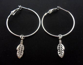"A pair of silver plated 30mm 1"" hoop and feather charm earrings."