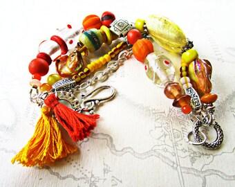 Boho bracelet yellow and orange ethnic beads, silver findings, tassels