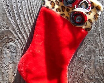 18 inch red and cheetah print faux fur stocking with red, green, white, gold, and silver handmade fabric flowers with bead & button centers