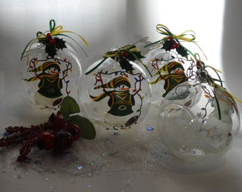 """4"""" Glass Globe Terrarium Ornament hand painted with a Packer Fan Snow Person holding string of colorful Christmas Lights"""