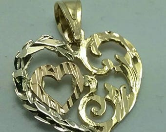 Solid 14k gold heart pendant.
