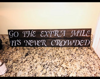 Go the extra mile pallet sign