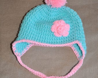 Aqua hat with pink flower applique and pink pom pom