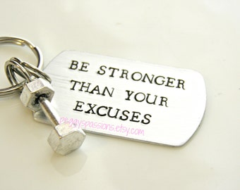 Be Stronger Than Your Excuses. Motivational hand stamped key chain with barbell charm.