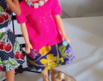Barbie Pink floral dress necklace and doll