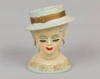 1950s Lady Head Vase Blue eyes Light hair Pearl earrings Blue dress with flowers Hat with gold ribbon Nice condition