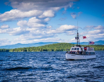 Boat in Lake Winnipesaukee in Weirs Beach, Laconia, New Hampshire. Photo Print, Metal, Canvas, Framed.