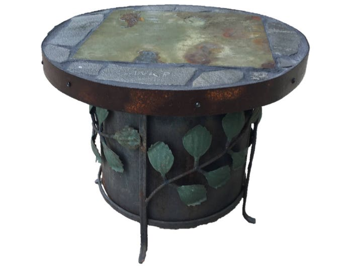 "Stash: An 18"" diameter x 15"" tall stone topped folk ark accent table."